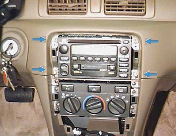 car audio stereo systems install cd dvd ipod iphone amps speakers 4 screw bolts holding stereo in dash remove in order to pull factory stereo from the car s dash use a socket wrench